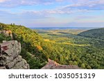 Beautiful Wisconsin summer nature background. Areal view from rocky ice age hiking trail during sunset hours. Devil