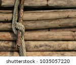 Small photo of White rope bind rusty steel rod wite stack bamboo background in day light
