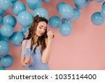 a tender girl in a blue dress ...   Shutterstock . vector #1035114400