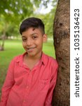 portrait of young indian boy... | Shutterstock . vector #1035136423