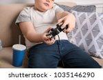 overweight boy playing... | Shutterstock . vector #1035146290