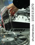 dj console and vinyl record in... | Shutterstock . vector #1035151870