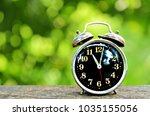 retro clock on wooden with... | Shutterstock . vector #1035155056