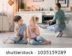 little kids eating cookies near ... | Shutterstock . vector #1035159289