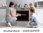 little kids watching their... | Shutterstock . vector #1035164959