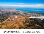 etna volcano from the airplane... | Shutterstock . vector #1035178708