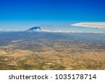etna volcano from the airplane... | Shutterstock . vector #1035178714