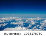 blue sky and clouds below from... | Shutterstock . vector #1035178750
