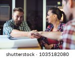 business people shaking hands ... | Shutterstock . vector #1035182080