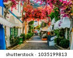street with white houses... | Shutterstock . vector #1035199813