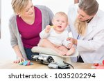 female pediatric care... | Shutterstock . vector #1035202294