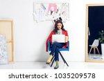 young female designer working... | Shutterstock . vector #1035209578