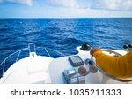 hand of captain on steering... | Shutterstock . vector #1035211333