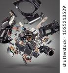 flying broken camera parts on... | Shutterstock . vector #1035213529