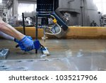 a metalworker water jet cutting ... | Shutterstock . vector #1035217906