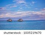 romantic water villas in... | Shutterstock . vector #1035219670