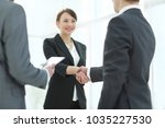 negotiating business image... | Shutterstock . vector #1035227530