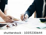 business team analyzing... | Shutterstock . vector #1035230644