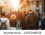 unrecognizable mass of people... | Shutterstock . vector #1035248026