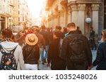 unrecognizable mass of people... | Shutterstock . vector #1035248026