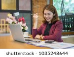 smiling businesswoman working... | Shutterstock . vector #1035248644