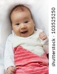 Portrait of cute happy baby, looking at camera. - stock photo