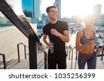 happy couple jogging and... | Shutterstock . vector #1035256399