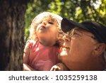 happy senior grandparent... | Shutterstock . vector #1035259138