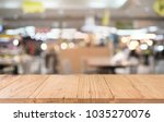 empty wood table top and blur... | Shutterstock . vector #1035270076