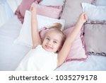 close up little girl waking up... | Shutterstock . vector #1035279178