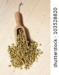 Chamomile flowers on natural wood - stock photo