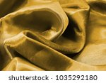 smooth folds of gold satin... | Shutterstock . vector #1035292180