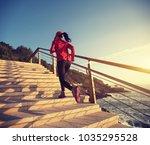sporty female runner running... | Shutterstock . vector #1035295528