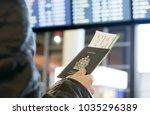 a man with a canadian passport... | Shutterstock . vector #1035296389