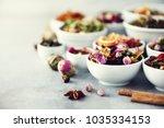 assortment of dry tea in white... | Shutterstock . vector #1035334153