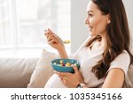 happy pregnant young woman... | Shutterstock . vector #1035345166