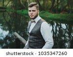 handsome elegant bearded groom... | Shutterstock . vector #1035347260