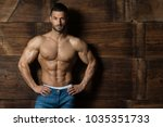 portrait of a young physically... | Shutterstock . vector #1035351733