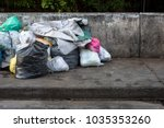road and footpath full of... | Shutterstock . vector #1035353260