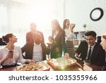the office staff eat pizza and... | Shutterstock . vector #1035355966