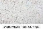 cracked concrete wall texture... | Shutterstock . vector #1035374203