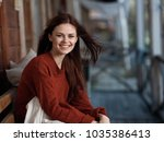 woman laughing sitting with... | Shutterstock . vector #1035386413