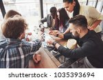 group of creative multietnic... | Shutterstock . vector #1035393694