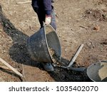 man at work on raw land for...   Shutterstock . vector #1035402070