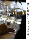 white wine glass   close up view   Shutterstock . vector #1035406108