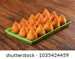 deep fried snack   coxinha | Shutterstock . vector #1035424459