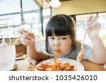hungry face and enjoy eating... | Shutterstock . vector #1035426010