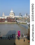 Small photo of London, UK - 23rd March 2012: Spring sunshine encourages visitors and Londoners alike to cross the River Thames on foot via the pedestrians only Millenium Bridge.