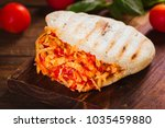 freshly cooked chicken arepa on ... | Shutterstock . vector #1035459880