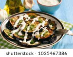 fried eggplants with garlic and ... | Shutterstock . vector #1035467386